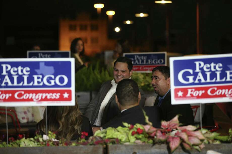 U.S. District 23 Democratic candidate Pete Gallego supporters Jeremy Sakulenzki, left, and Alfonso Lujan wait for results as they gather at the Paramour on election night, Tuesday, Nov. 8, 2016. Gallego is up against Republican incumbent Will Hurd. Photo: JERRY LARA, Staff / San Antonio Express-News / © 2016 San Antonio Express-News