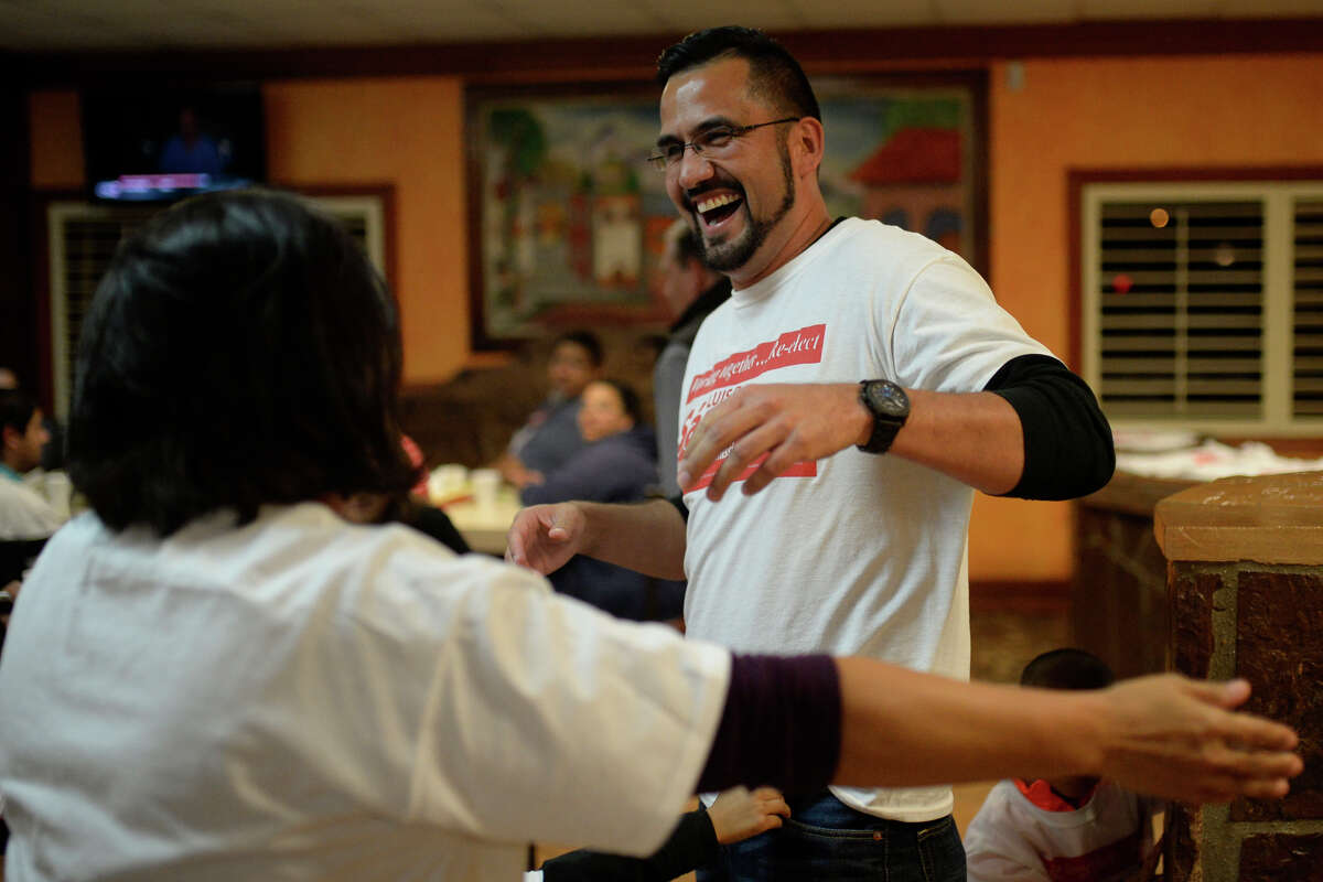 Luis Sanchez, running for re-election as county commissioner in precinct 3, hugs his aunt after announcing a victory during an election watch party Tuesday, Nov. 8, 2016, at Martinez Bakery. James Durbin/Reporter-Telegram