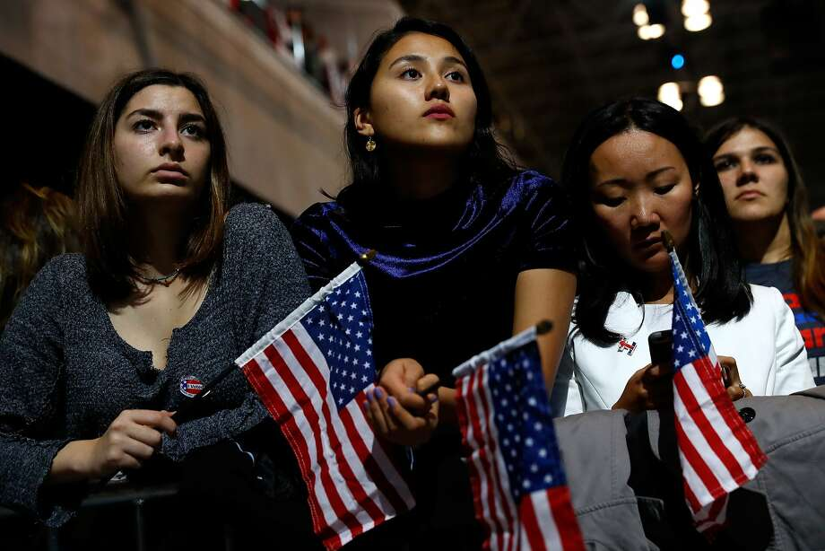 NEW YORK, NY - NOVEMBER 08:  People hold American flags as they watch voting results at Democratic presidential nominee former Secretary of State Hillary Clinton's election night event at the Jacob K. Javits Convention Center November 8, 2016 in New York City. Clinton is running against Republican nominee, Donald J. Trump to be the 45th President of the United States.  (Photo by Aaron P. Bernstein/Getty Images) Photo: Aaron P. Bernstein, Getty Images