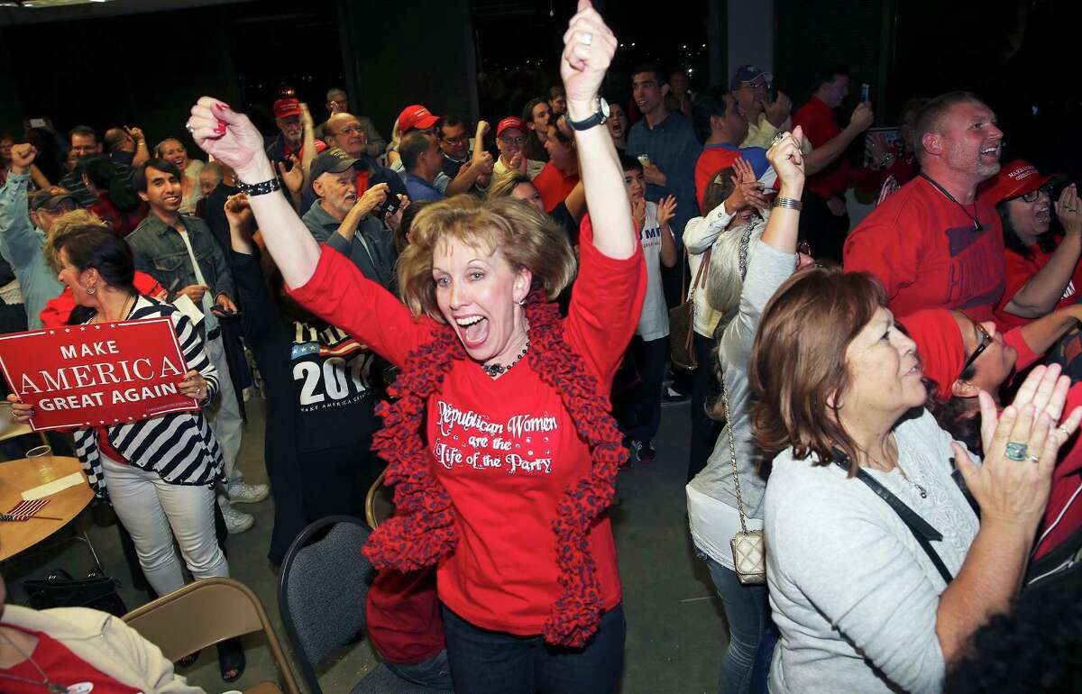 Cynthia Smith, legal counsel for Republicans, goes in to a happy dance over results from Florida as Republicans hold their election night watch party at their headquarters at 909 NE Loop 410 on November 8, 2016.