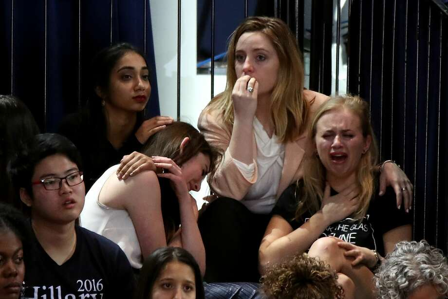 A group of women react as voting results come in at Democratic presidential nominee former Secretary of State Hillary Clinton's election night event at the Jacob K. Javits Convention Center November 8, 2016 in New York City. Clinton is running against Republican nominee, Donald J. Trump to be the 45th President of the United States. Photo: Drew Angerer/Getty Images