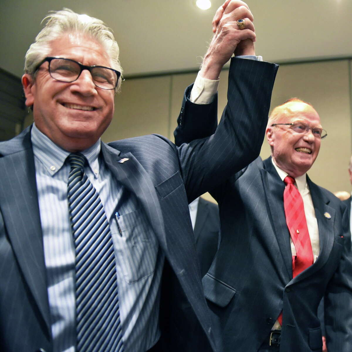 State Senate candidate Jim Tedisco, left, has his hand raised in victory by out-going Senator Hugh Farley during the Saratoga County Republican Committee gathering Tuesday Nov. 8, 2016 in Saratoga Springs, NY. (John Carl D'Annibale / Times Union)
