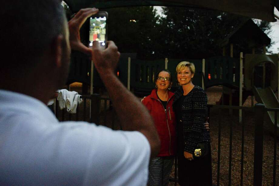 State Rep. Jim Murphy takes a photo Tuesday of State Rep. Sarah Davis, right, with supporter Lisa White Watkins outside the Colonial Park Recreation Room. Photo: Erin Hull / Erin Hull