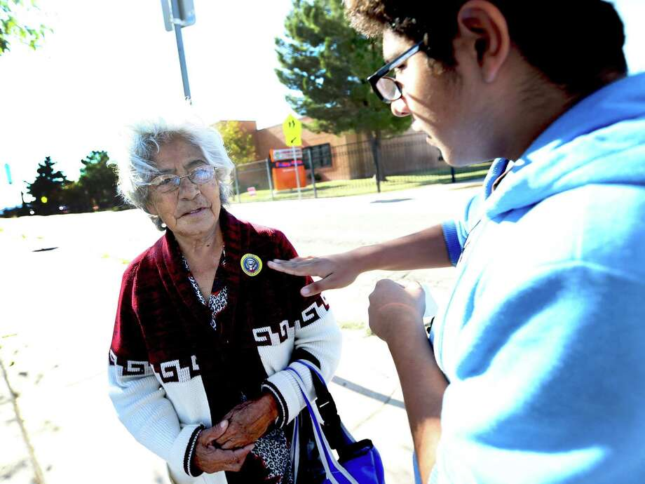 "Pedro Estrada puts an ""I voted"" sticker on his grandmother Andrea Estrada after she voted at El Paso's Cedar Grove Elementary. Photo: Victor Calzada, MBI / El Paso Times"