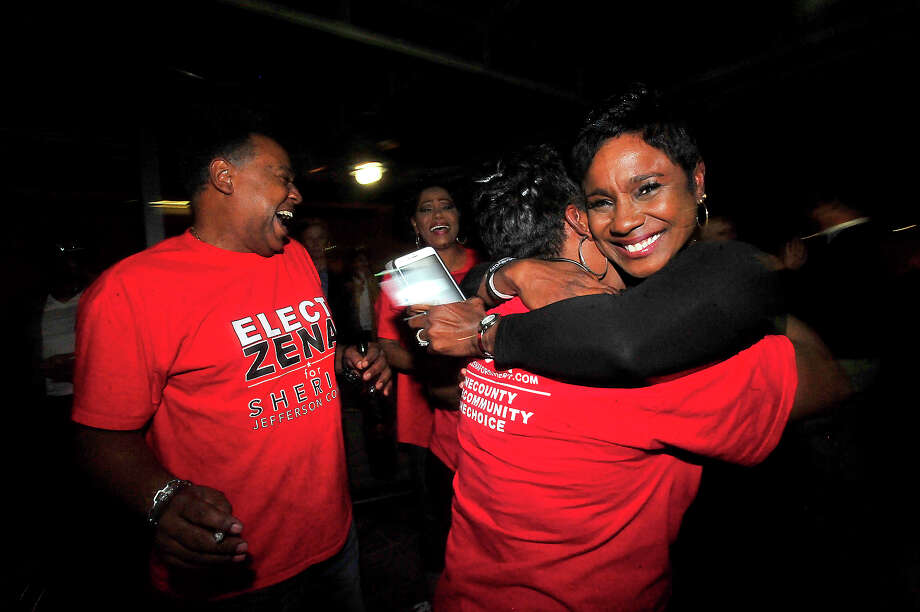 Zena Stephens, Democratic candidate for Jefferson County Sheriff, is swarmed by supporters offering hugs of congratulations and celebrating her win over Republican Ray Beck as she and supporters gather for an election result party at Suga's in Beaumont Tuesday. Photo taken Tuesday, November 8, 2016 Kim Brent/The Enterprise Photo: Kim Brent / Beaumont Enterprise