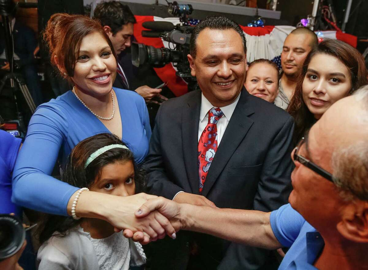 Ed Gonzalez, along with his wife, Melissa, and daughter Erika, 7, greets supporters Tuesday during an election watch party at Fitzgerald's.