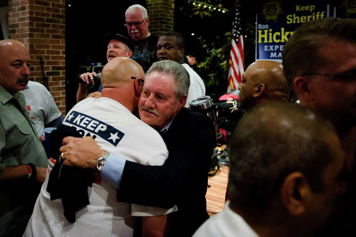 Harris County Sheriff Ron Hickman, right, embraces Sgt. Ron Hamlet after speaking to the crowd gathered at his election party Tuesday, when he was defeated by challenger Ed Gonzalez.