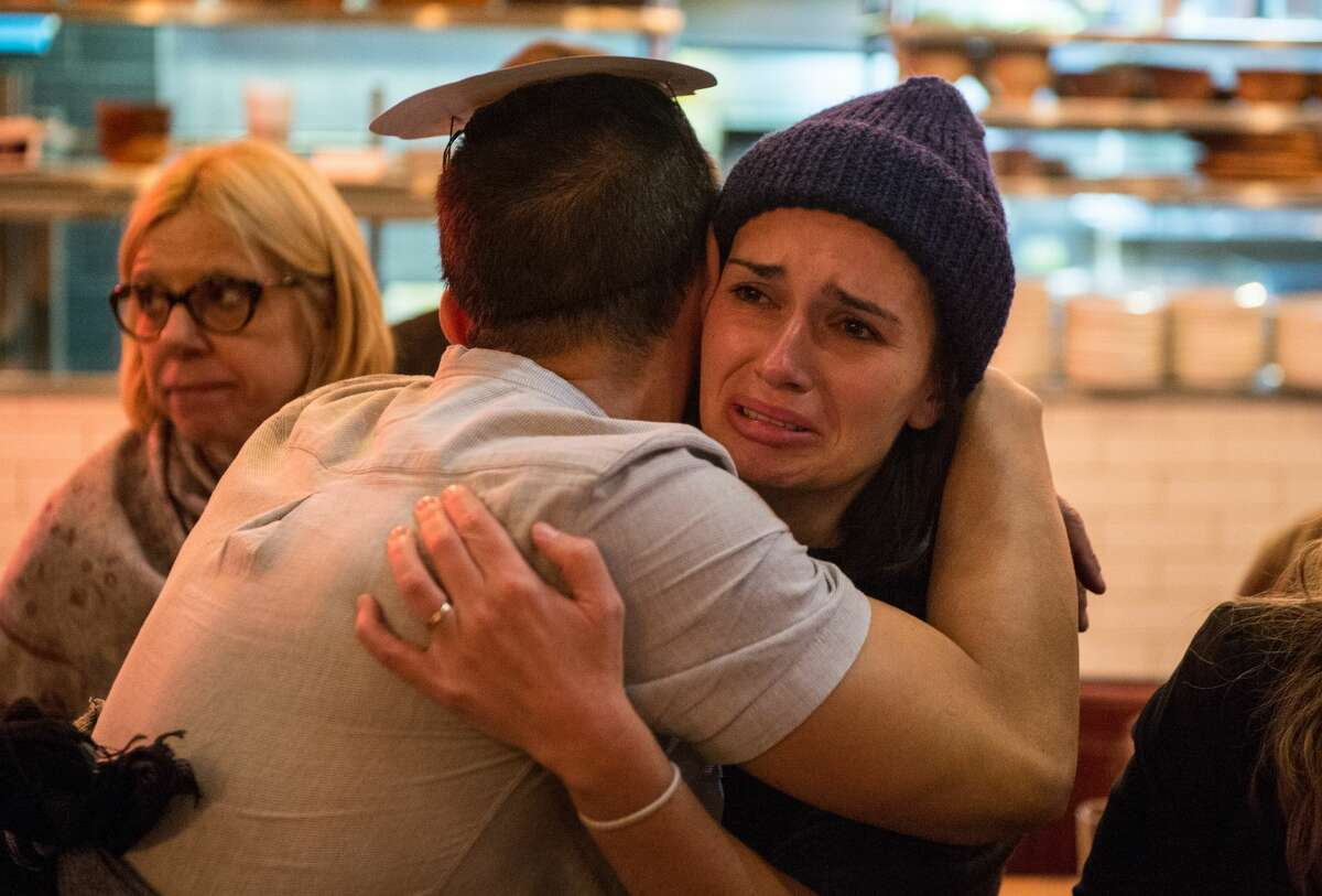 An American Democratic Party supporter cries after Donald Trump wins the state of Florida at the Democrats Abroad election night party at Marylebone Sports Bar and Grill on November 8, 2016 in London, England.