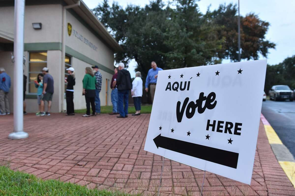 Voters wait in line to cast their ballot's at the Hollywood Park City Hall early Tuesday morning.