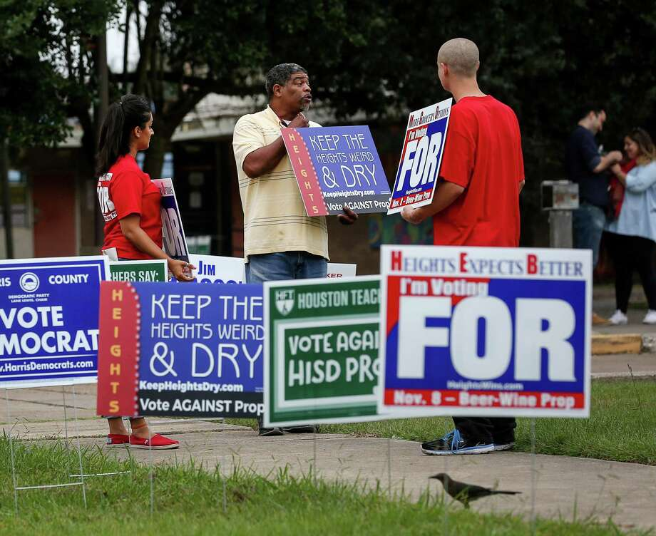 Kasey Barnett, center, talks with Puja Kapoor, an HEB employee, left, and Sebastian Small, both supporters of Prop. 1, at the Love Park Community Center in the Heights Tuesday. Photo: Jon Shapley, Staff / © 2015  Houston Chronicle