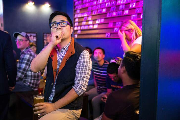 Lawrence Mak, a supporter, checks the elections, during Scott Wiener's election night party at Beaux, on Tuesday, Nov. 8, 20166 in San Francisco, Calif. Wiener is a state Senate candidate.