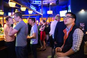 Lawrence Mak, a supporter, checks the elections, during Scott Wiener's election night party at Beaux, on Tuesday, Nov. 8, 2016 in San Francisco, Calif. Wiener is a state Senate candidate.