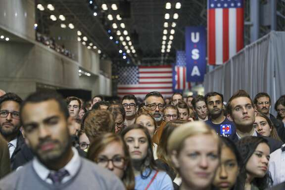 People watch as results come in at Hillary Clinton's election night event at the Javits Center in New York, Nov. 8, 2016. (Todd Heisler/The New York Times)