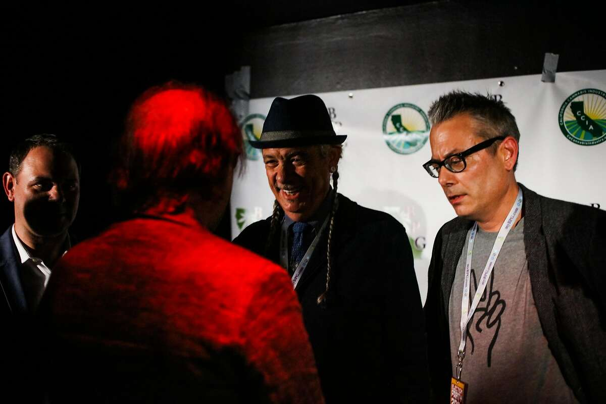 (l-r) Troy Dayton, Henry Wykowski, Steve DeAngelo, and Andrew DeAngelo who are in the cannabis industry chat ahead of the Berkeley Patients Group Party to celebrate Prop 64, at The New Parish Oakland, California, on Tuesday, Nov. 8, 2016.