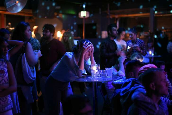 Clinton supporter Shoshanna Moody of San Francisco holds her head in her hands as she watches election results putting Trump in the lead, at the Oasis Nightclub in San Francisco, CA, Tuesday, November 8, 2016.