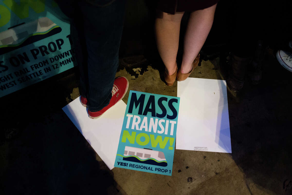 Sound Transit 3 posters are scattered on the ground at The Crocodile during a watch party for the mass transit proposition on election night last Nov. 8. Voters approved the plan, which would build 62 miles of light rail, among other projects, with 53.9 percent of the vote.