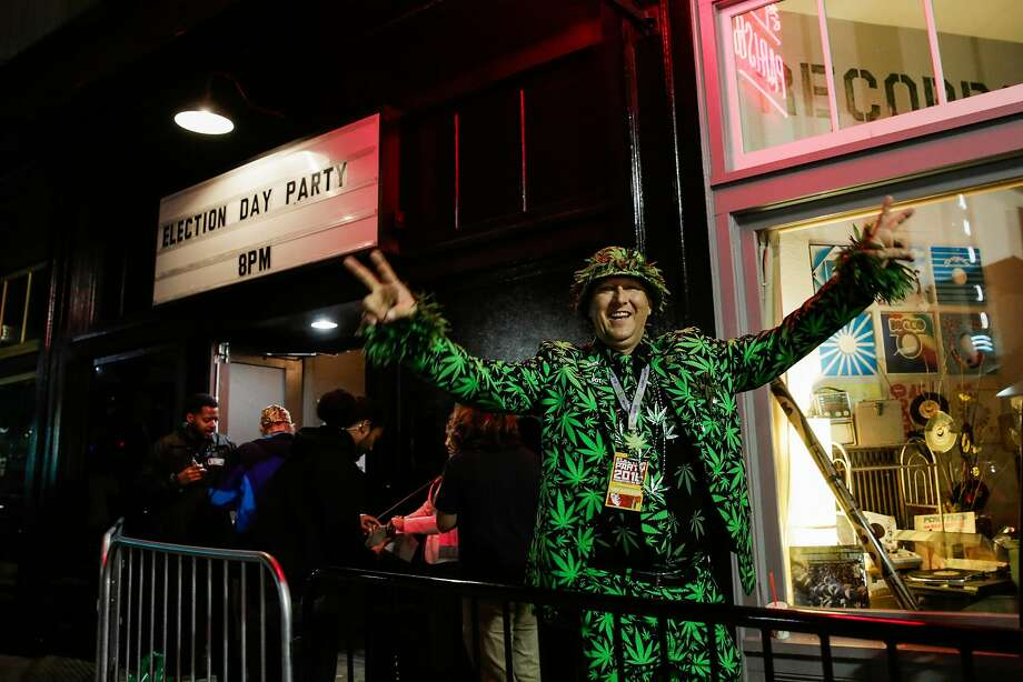 A man named Big Mike cheered after the announcement of the passing of Prop. 64 outside the Berkeley Patients Group Party. Photo: Gabrielle Lurie, The Chronicle