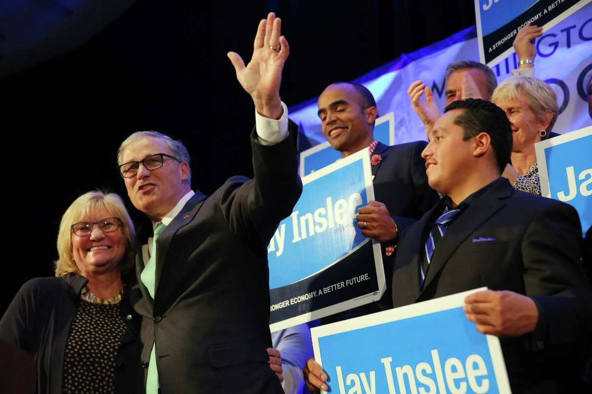Washington State Governor Jay Inslee and his wife Trudi address the crowd as Inslee wins second term, at the Washington Democrats election night party, Tuesday, Nov. 8, 2016, at the Seattle Westin.