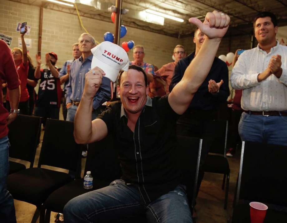 Chris Pancheri holds a Trump cap during an election watch party at the Harris County Republican Party offices on Tuesday. Photo: James Nielsen, Houston Chronicle / Copyright 2016 Houston Chronicle