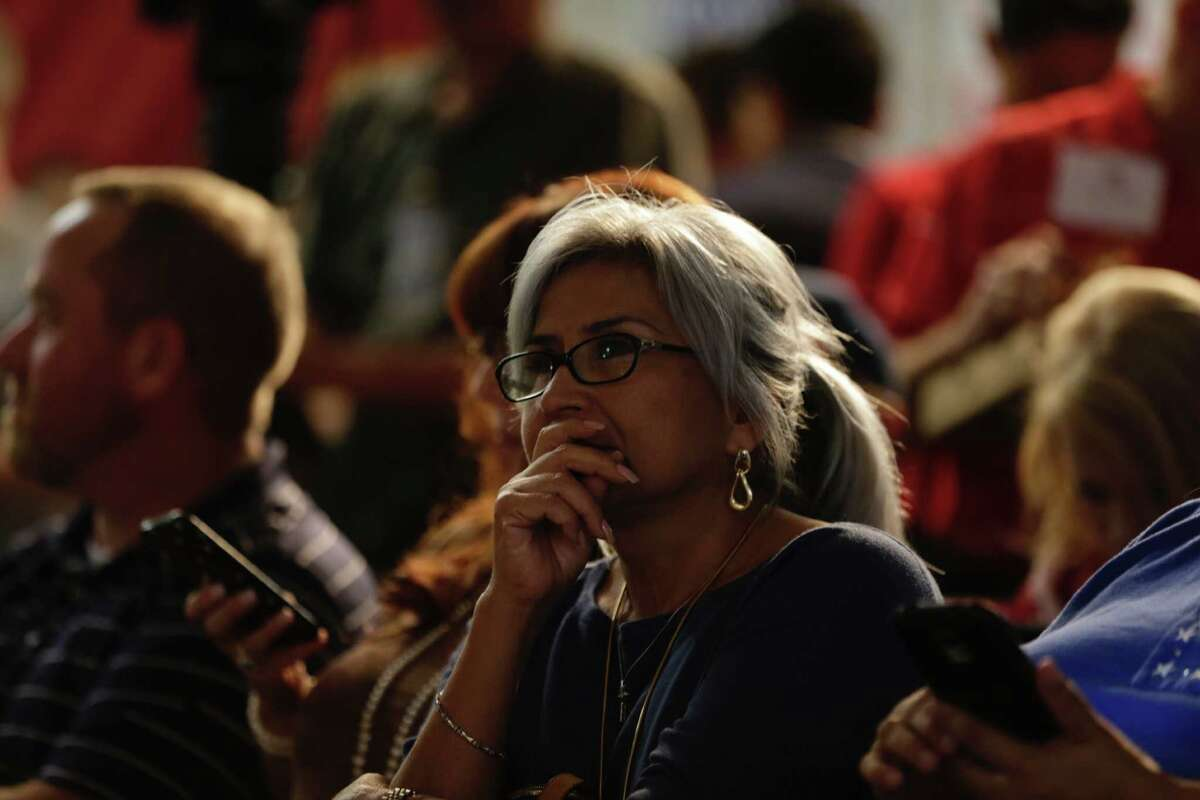 Rosie Smith watches results during an election watch party at the Harris County Republican Party on Tuesday.