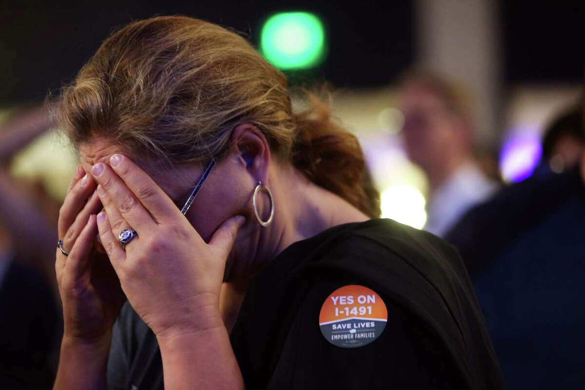 Monica Mischaikow reacts to election results at the Washington Democrats election night party.
