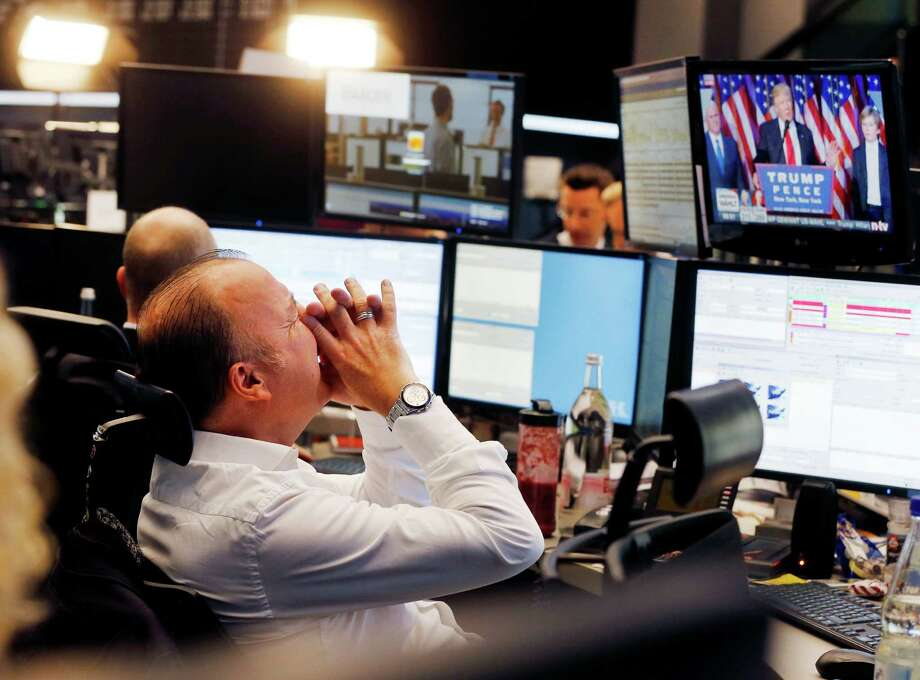 A broker reacts as the newly elected U.S. President Donald Trump shows up on a television screen at the stock market in Frankfurt, Germany. Photo: Michael Probst, AP / Copyright 2016 The Associated Press. All rights reserved.