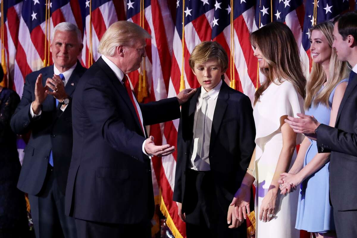 Republican president-elect Donald Trump acknowledges his son Barron Trump (C) after delivering his acceptance speech at the New York Hilton Midtown in the early morning hours of Nov. 9, 2016 in New York City. Social media users noted the 10-year-old looked awfully tired while his father spoke to the American people that night.