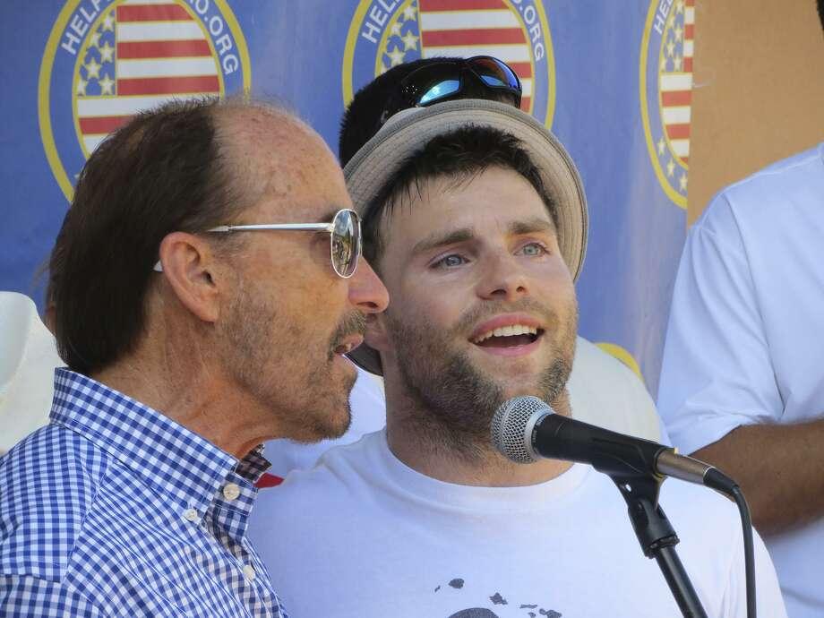 Lee Greenwood (left) and wounded veteran/singer J.P. Lane team up. Photo: Express-News File Photo / San Antonio Express-News