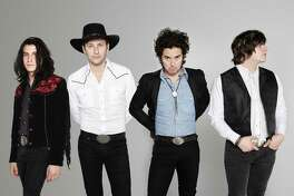 Diego, left, and Emilio IV, right, play in the up-and- coming country-rock band Last Bandoleros. Their band mates are Derek James, second from left, Jerry Fuentes.