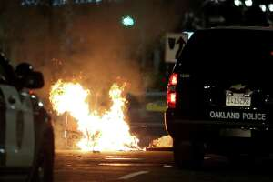 A trash fire burns during protests in Oakland, Calif., late Tuesday, Nov. 8, 2016. President-elect Donald Trump's victory set off multiple protests. (Anda Chu/Bay Area News Group via AP)
