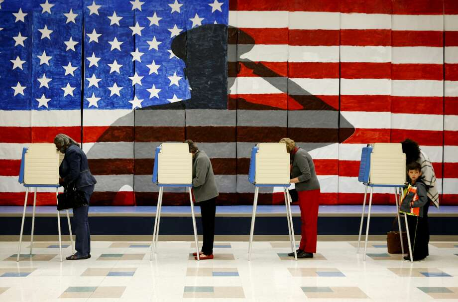 Voters line up in voting booths to cast their ballots at Robious Elementary School in Chesterfield, Va. on Tuesday Nov. 8, 2016. (Shelby Lum/Richmond Times-Dispatch via AP) Photo: SHELBY LUM / TIMES-DISPATCH/AP
