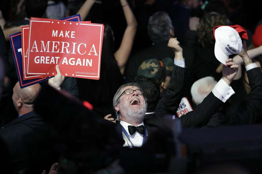 Supporters of Republican presidential candidate Donald Trump react as they watch the election results during Trump's election night rally, Tuesday, Nov. 8, 2016, in New York. (AP Photo/John Locher) Photo: John Locher/AP