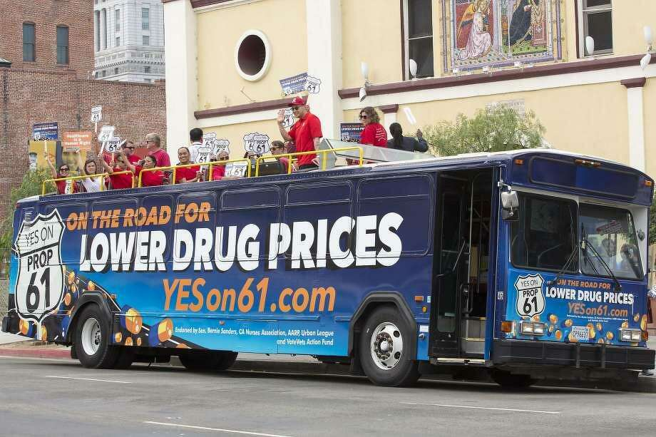 Supporters of Proposition 61, the California Drug Price Relief Act, gathered atop a double-decker bus at La Placita Olvera, the heart of Los Angeles on Monday, Sept. 19, 2016. California voters defeated the measure Tuesday. Photo: Gilles Migasson / Associated Press / Gilles Migasson / Associated Press