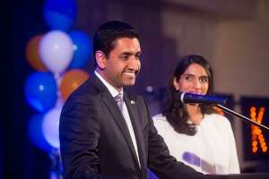 Ro Khanna, who defeated incumbent U.S. Rep. Mike Honda in the race for Congressional District 17, speaks at an election night party on Tuesday, Nov. 8, 2016, in Fremont, Calif. At right is his wife Ritu Khanna.