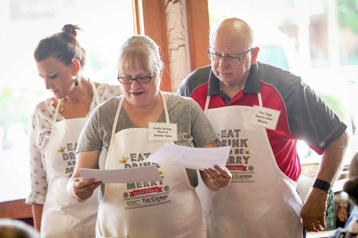 Leslie Syring-Becerra, of the Courier sales team, announces winners during the 27th Annual Holiday Cooking Contest on Saturday, Oct. 29, 2016, at McKenzie's Barbeque in Conroe.