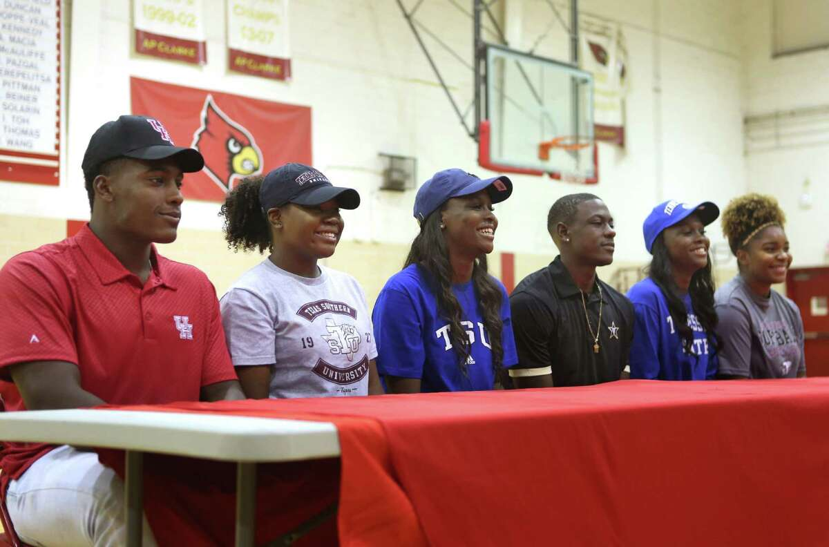Bellaire athletes (LtoR) Ronald Brown, Paige Jackson, Maya Evans, Maxwell Evans, Megan Evans and Chelsea Baxter are photographed after participating in a signing ceremony at Bellaire High School, Tuesday, Nov. 8, 2016. Ronald Brown is signing with the University of Houston to play baseball. Paige Jackson and Chelsea Baxter both intend on playing softball at Texas Southern University. Megan and Maya Evans intend on attending Tennessee State University while Maxwell Evans is signing with Vanderbilt University.