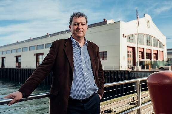 Gordon Knox, the incoming president of the San Francisco Art Institute in front of the future SFAI Graduate Center at Fort Mason .photo credit is Duy Ho
