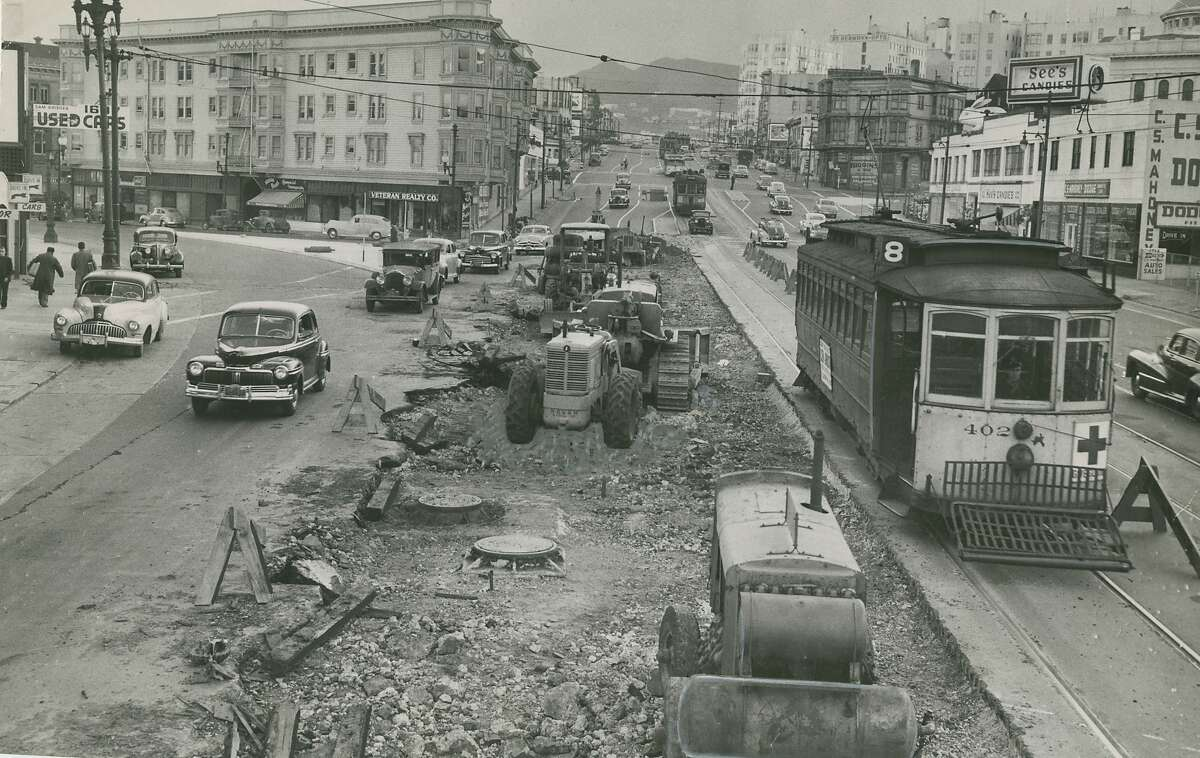 Market, Valencia and Gough Streets in San Francisco, being repaired. April 3, 1949.