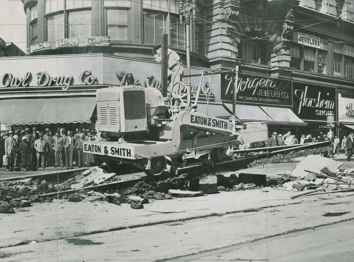 Track and railroad ties being pulled up and replaced on Market Street in San Francisco, April 26, 1948. Owl Drugs, Morger Jewelry and Florsheim Shoes are seen in the photo.