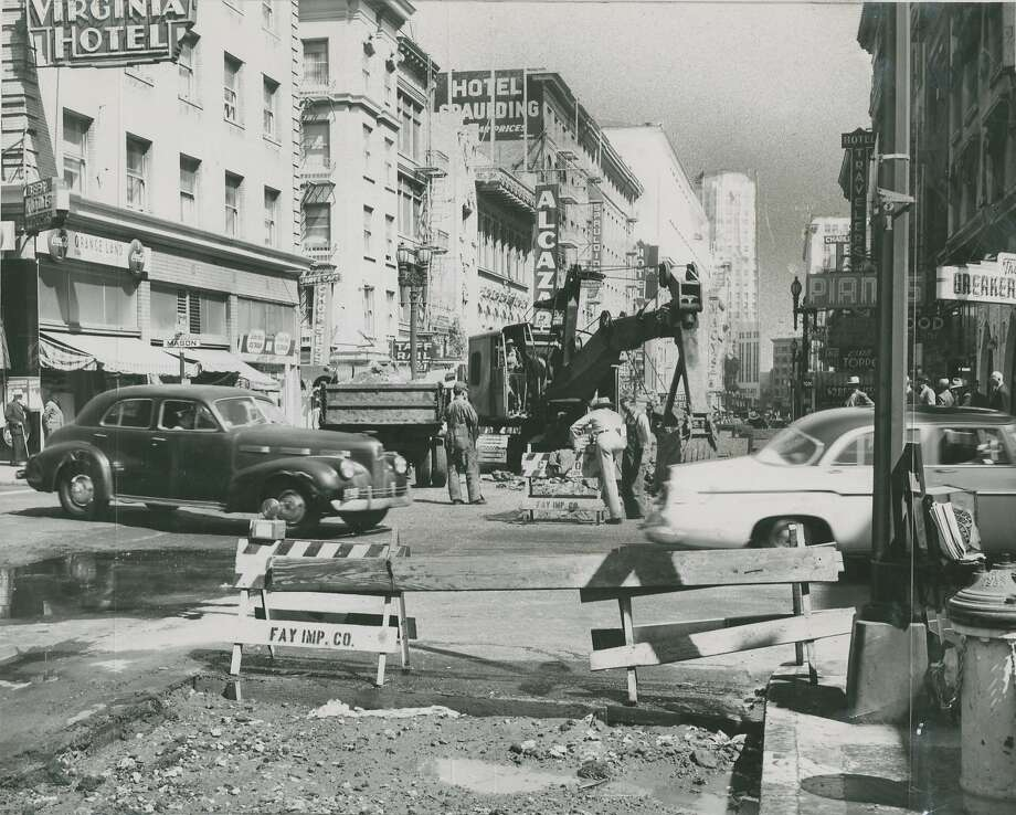 Street repair being done on Mason and O'Farrell Streets in San Francisco, September 25, 1955. Seen in the photo are the Virginia Hotel, Hotel Spaulding and Alcazar Theater. Photo: Art Frisch, San Francisco Chronicle