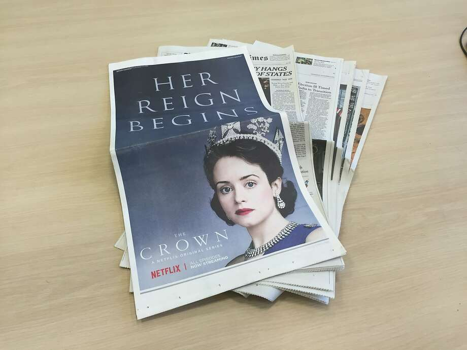"A print advertisement wrapped around Wednesday's New York Times promotes ""The Crown,"" a new Netflix original series. Photo: Owen Thomas / The Chronicle"