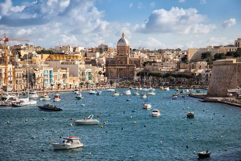 Malta, an island nation south of Italy, is obviously beautiful, and it's also quite inexpensive. Many retired expats currently reside in the small country, but share the place with the tourists who come to visit when it gets warm. If you're planning on living there longer than three months, there area few things you have to do. After securing a job (you'll probably need to go there to job hunt in person), you gather up the materials requested by the government, turn them in, and that should be enough to allow you to live there.