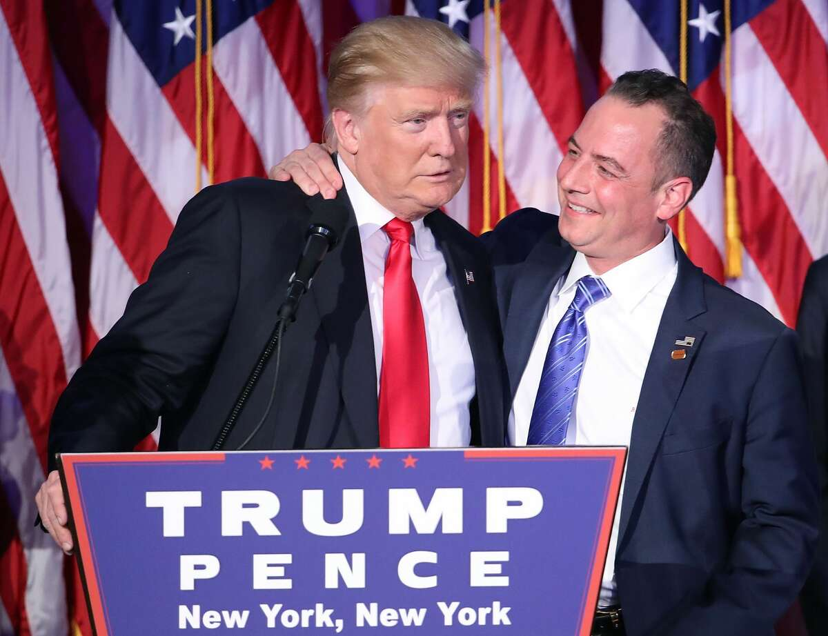 Republican president-elect Donald Trump and Reince Priebus, chairman of the Republican National Committee, embrace during his election night event at the New York Hilton Midtown in the early morning hours of November 9, 2016 in New York City. Donald Trump defeated Democratic presidential nominee Hillary Clinton to become the 45th president of the United States.