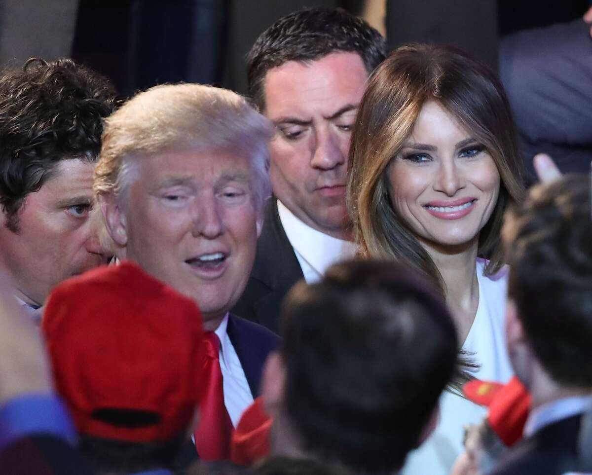 Republican president-elect Donald Trump along with his wife Melania Trump (Center-R) greet people in the crowd after delivering his acceptance speech at the New York Hilton Midtown in the early morning hours of November 9, 2016 in New York City. Donald Trump defeated Democratic presidential nominee Hillary Clinton to become the 45th president of the United States.