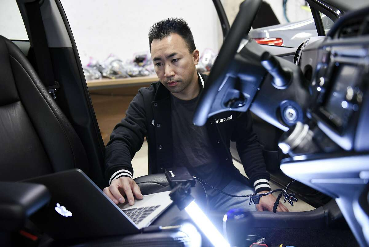Auto technician Crosby Chan uses a laptop for testing while installing a Getaround Connect hardware device into a City CarShare vehicle in the garage at Getaround's offices in San Francisco, CA, Wednesday, November 9, 2016. Getaround, which arranges car rentals by the hour or day, is partnering with SF's City CarShare, and will manage its fleet of 200 cars.