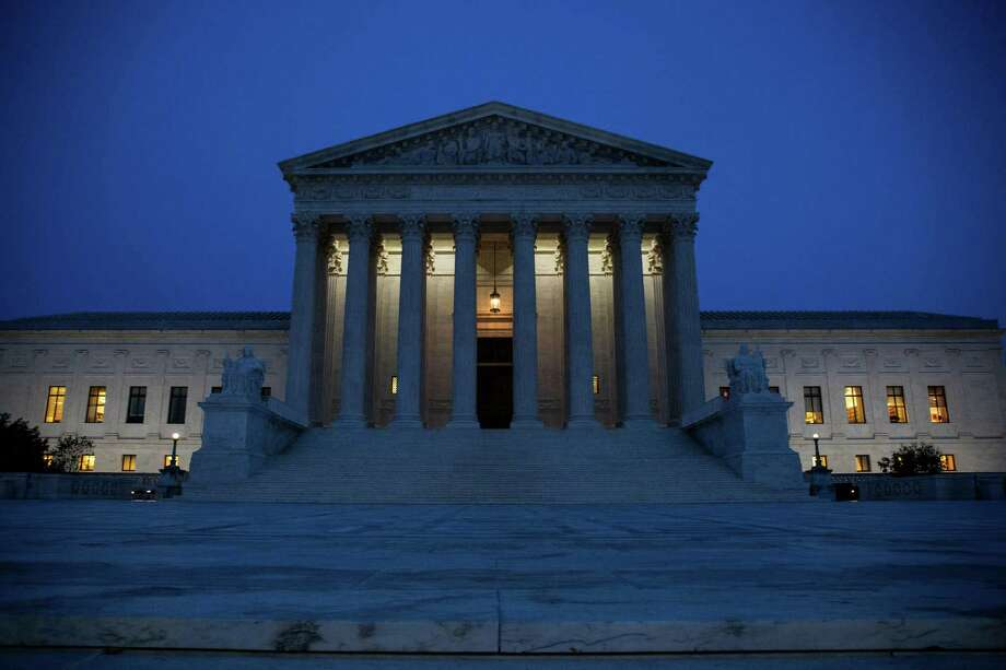 WASHINGTON, DC - NOVEMBER 08: The U.S. Supreme Court is pictured on November 8, 2016 in Washington, DC. Americans today will choose between Republican presidential candidate Donald Trump and Democratic presidential candidate Hillary Clinton as they go to the polls to vote for the next president of the United States. (Photo by Zach Gibson/Getty Images) Photo: Zach Gibson, Stringer / Getty Images / 2016 Getty Images