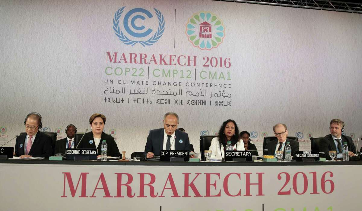 From the left, Hoesung Lee, chairman of the Intergovernmental Panel on Climate Change, Patricia Espinosa, U.N. climate, and Moroccan Foreign Minister and COP22 president Salaheddine Mezouar, attend the opening session of the Climate Conference in Marrakech, Morocco, Monday Nov. 7, 2016. Climate negotiators have started work on implementing the Paris pact on global warming amid uncertainty over how the U.S. election will impact the landmark deal as temperatures and greenhouse gases soar to new heights. Others are unidentified. (AP Photo/Mosa'ab Elshamy)