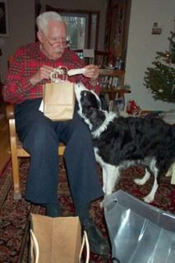 Kenneth Merrill Gleszer with is border collie, a dog that relatives said brought him great comfort in his later years. Photo: Contributed Photo / Hearst Connecticut Media / The News-Times Contributed