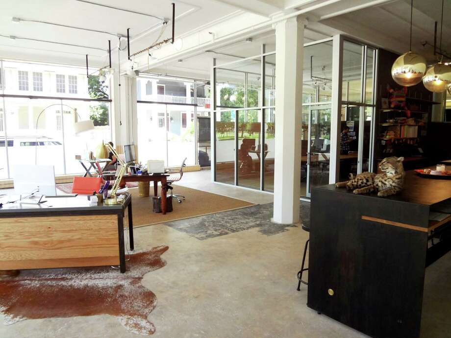 The TradeCraft offices in the Cadillac Lofts downtown feature a glass-walled conference room, high ceilings, electrical boxes and tubing on the ceiling, and old octagonal pillars. Photo: Steve Bennett / San Antonio Express-News