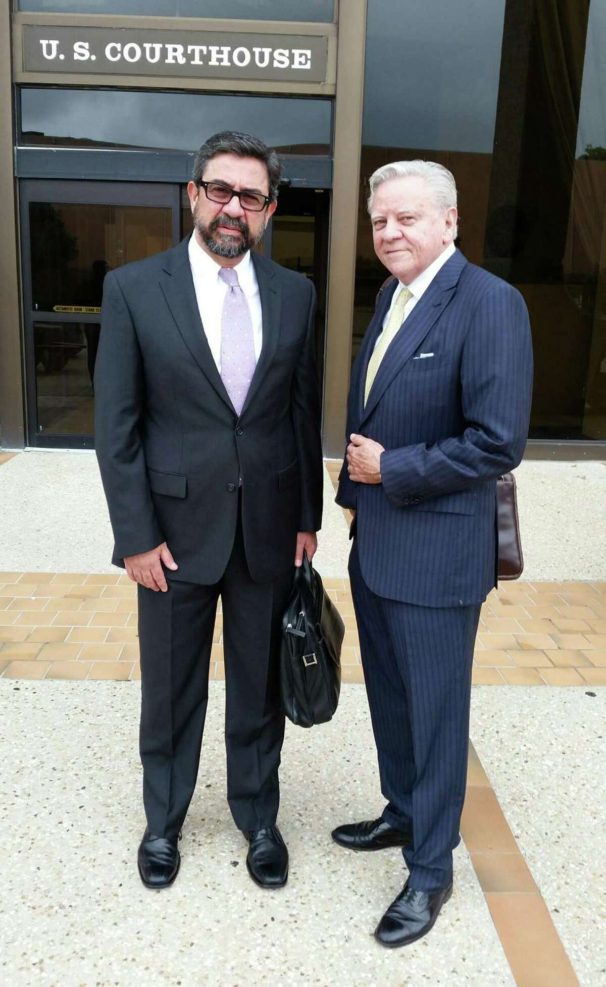 Businessman Alberto Berlanga Bolado, left, and his lawyer, Rolando Rios, stand outside federal court in San Antonio last May after reaching a settlement in a forfeiture case involving valuable land authorities alleged was bought for an indicted former Mexican governor. The land now has sold for $7 million, of which the government will get $1 million.